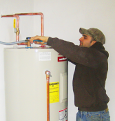 one of our Thornton water heater repair pros is fixing a broken unit